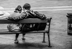 Canva grayscale photo of two person sitting on a bench